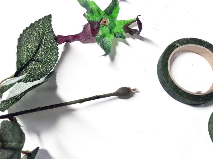 silk rose head removed from stem to make paper money flowers