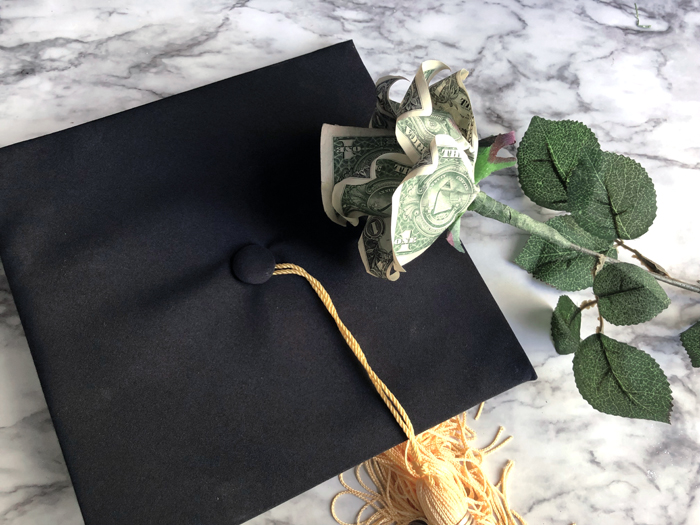 single money rose on mortar board
