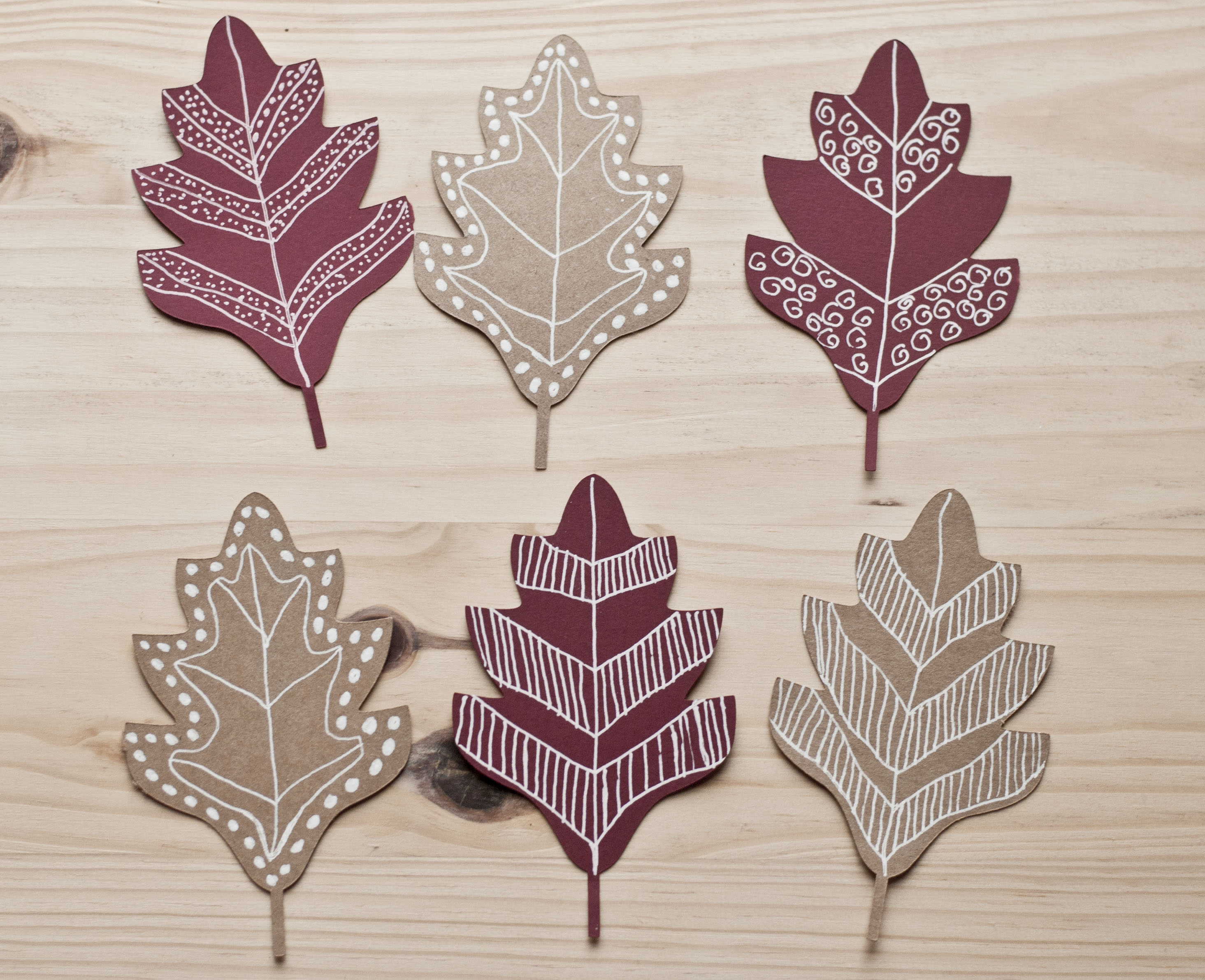 paper leaves decorated with doodle art