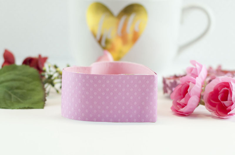 paper strip glued onto heart shaped paper mache box