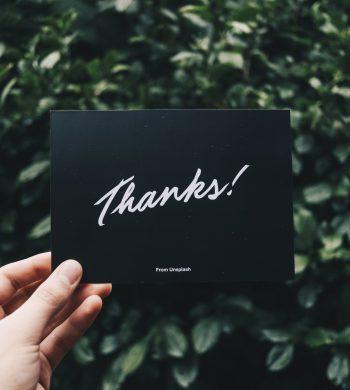 hand holding thankyou card