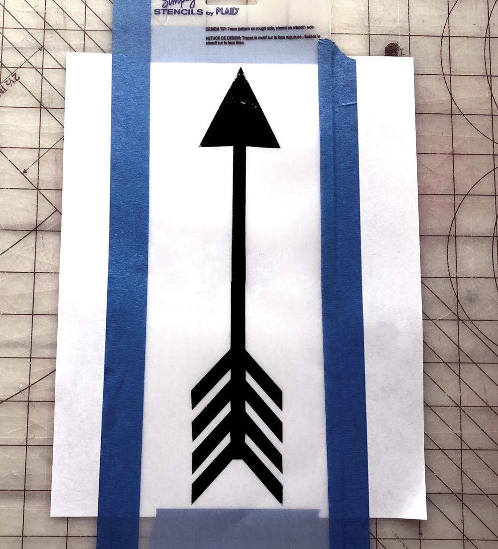 cutting an arrow stencil