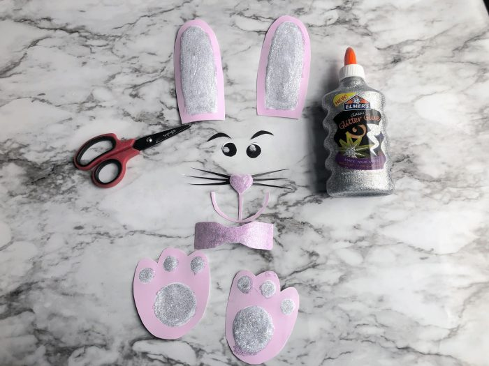 Easter Bunny Lunch Bag paper bunny parts and Elmers silver glitter glue