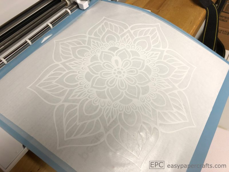 DIY Boho Mandala Serving Tray sticker on a cricut mat