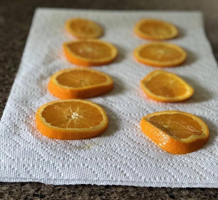 orange slices on a paper towel