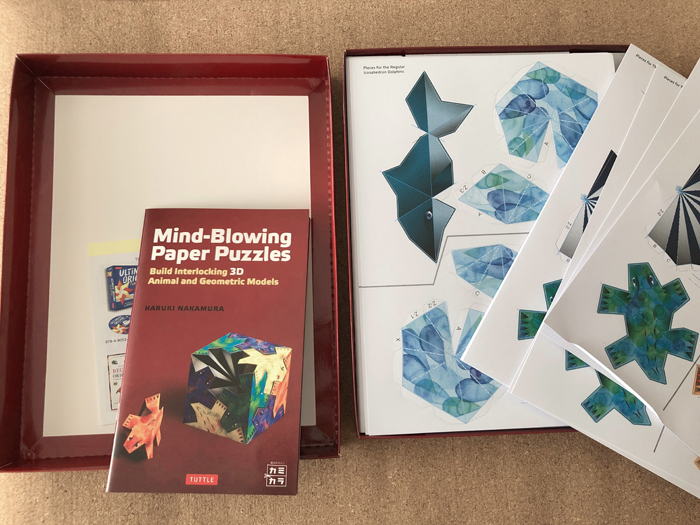 Inside of Mind-Blowing Paper Puzzles Kit: Build Interlocking 3D Animal and Geometric Models craft kit box (3d Paper Crafts)