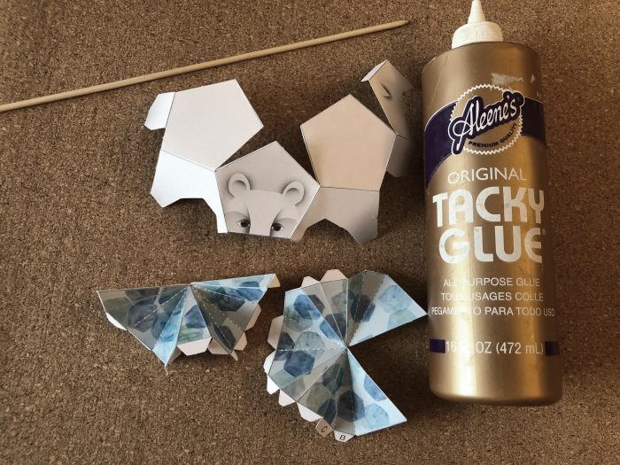 scored and folded paper bear pieces plus bottle of glue