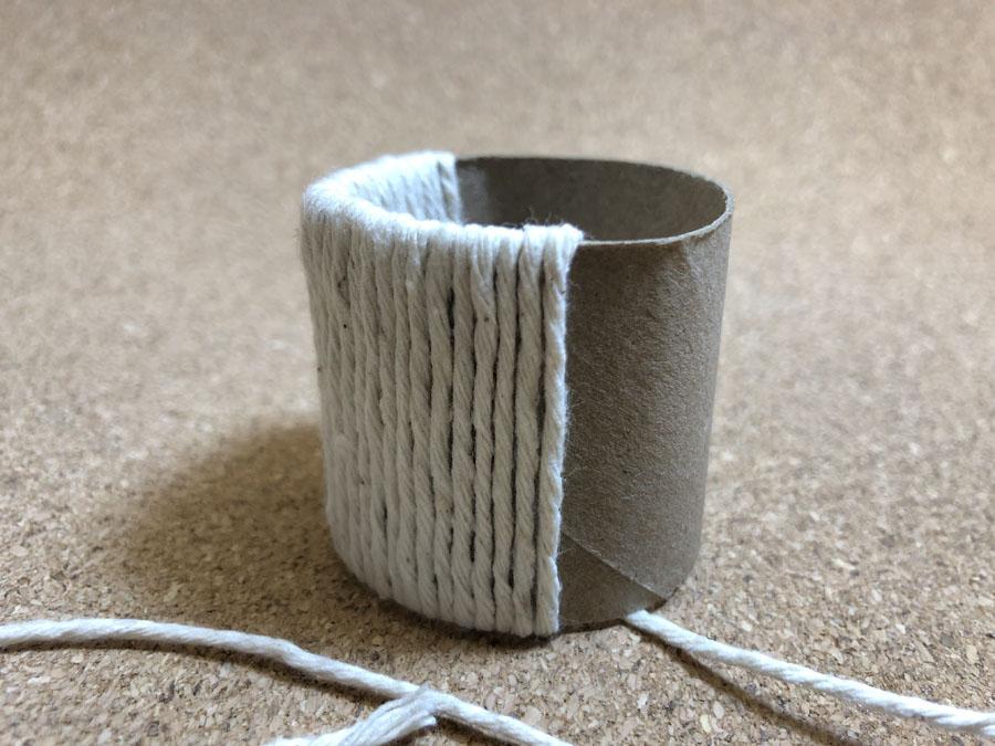 twine wrapped around paper tube napkin ring